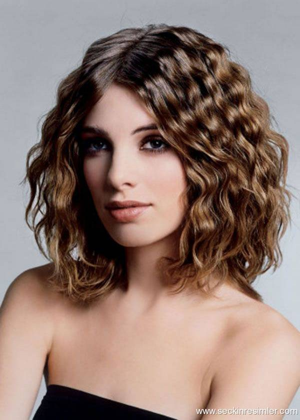 Poluduga kosa uvijena krpicama